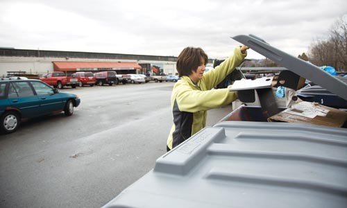Good riddance: Melissa Ortego drops off cardboard at Construction Junction's recycling station.