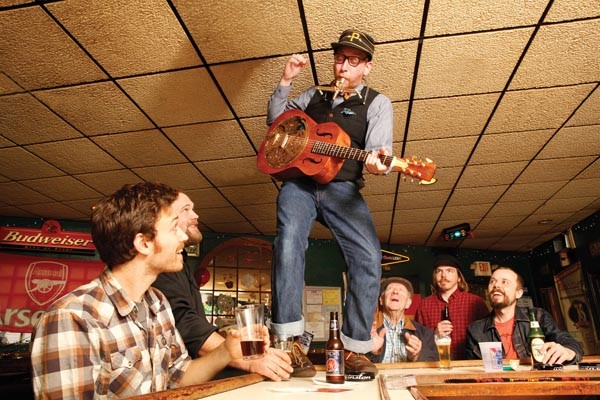 Great kazoo! Sussman plays for the regulars at Sonny's Tavern. - PHOTO BY HEATHER MULL