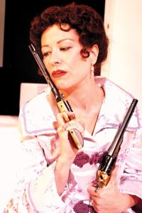 Gun crazy: Robin Walsh in PICT's Hedda Gabler. Photo by Suellen Fitzsimmons.