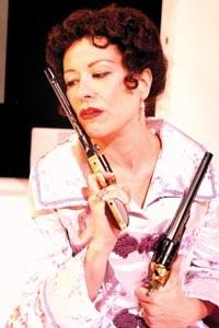 Gun crazy: Robin Walsh in PICT's Hedda Gabler. Photo by Suellen Fitzsimmons.
