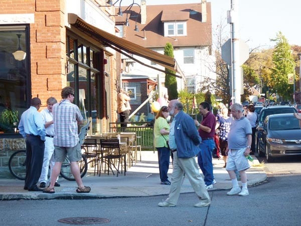 """Highland Park residents celebrate the redevelopment of Bryant Street during a recent """"Bite of Bryant"""" festival."""
