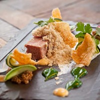"""Butcher and the Rye House-made pork terrine with homemade pickles, kimchee crackers, bread and cilantro purees, and foie gras """"snow."""" Photo by Heather Mull"""