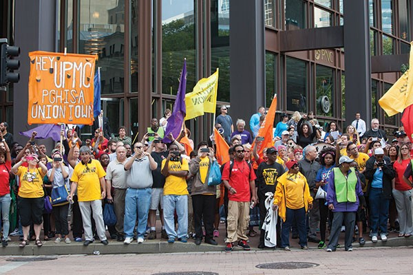 Hundreds of demonstrators gather at a rally outside UPMC's Downtown headquarters July 30.