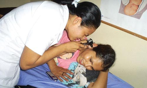 In Nicaragua, a donated opthalmoscope is used. - PHOTO: COURTESY OF GLOBAL LINKS.