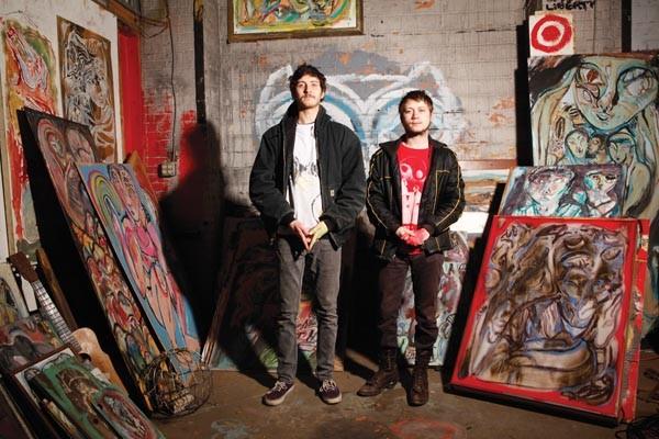 Innovators of Renfrew folk: John Chriest (left) and Dean Cercone, with Cercone's paintings