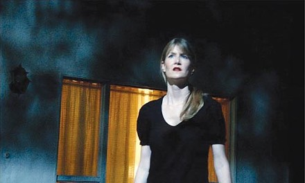 It's all set: Nikki Grace (Laura Dern) gets disoriented on a dimly lit movie soundstage in Inland Empire.