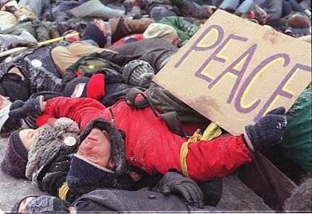 "January 2003: Peace protesters held a ""die-in"" in Oakland to protest the coming Iraq war - PHOTO BY HEATHER MULL"