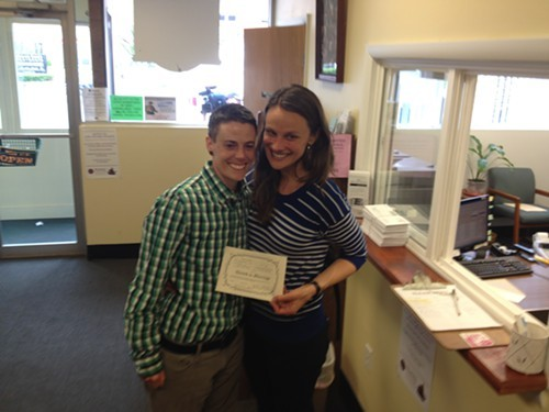 Jess Garrity, left, and Pamela VanHaitsma with their marriage license