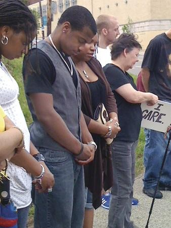 Jordan Miles prays with supporters at a May 14 rally at the Pittsburgh Police headquarters. - PHOTO BY SARA GAUL
