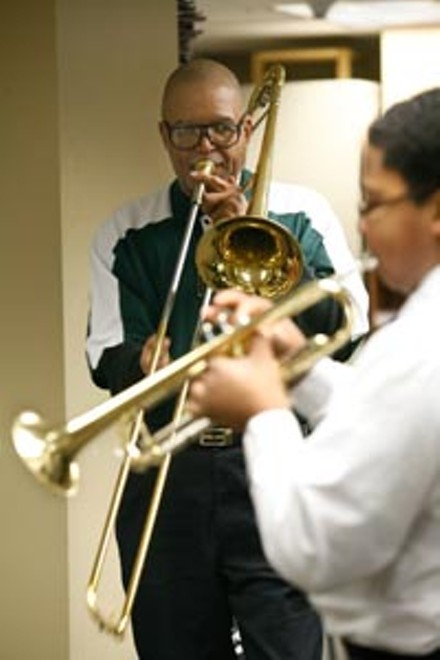 Keeping jazz alive: Dr. Nelson Harrison teaches a 6th grader at Northside Urban Pathways - HEATHER MULL