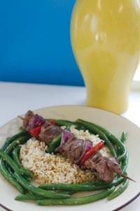 Lamb souvlaki shish kebab with garlic green beans and rice - HEATHER MULL