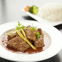 Royal Myanmar Lemongrass beef with coconut rice Photo by Heather Mull