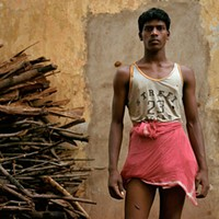 Local photographers document the aftermath of an attack on an Indian village.