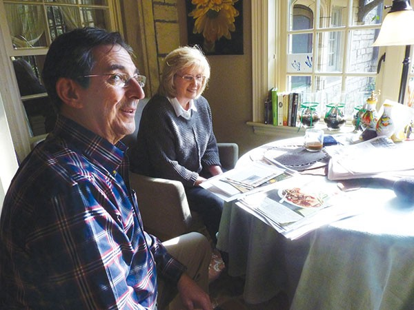 Lou and Kathy Testoni look through Lou's folder of Thanksgiving recipes