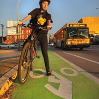 Lucia Aguirre celebrates Best News for Cyclists — new bike lanes on city streets.