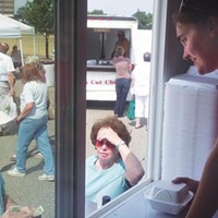 Lynne Szarnicki serves pierogies from the Pierogi Truck at the Green Tree Park farmers' market.