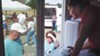 Lynne Szarnicki serves pierogies from the Pierogi Truck at the Green Tree Park farmers' market.