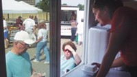 Lynne Szarnicki serves pierogies from the Pierogi Truck at the Green Tree Park farmers' market. - PHOTO BY AMYJO BROWN