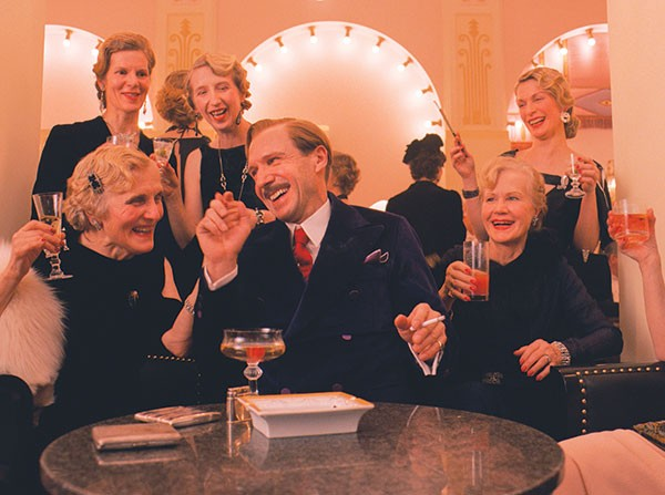 M. Gustave (Ralph Fiennes) charms the ladies.