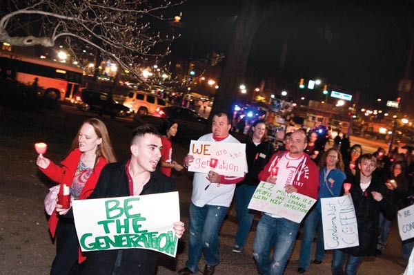 Marchers rallied Dec. 2 to observe World AIDS Day. Researchers are still battling the disease, and the stigma that comes along with it.