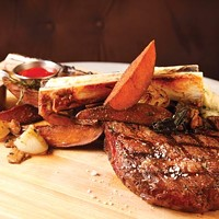 Meat and Potatoes for Two: tomahawk steak, confit potatoes and wild mushrooms