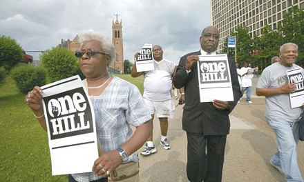Members of One Hill marched from Freedom Corner to the Mellon Arena on June 4 to make sure the community benefits from the construction of a new Penguins Arena. - PHOTO BY HEATHER MULL