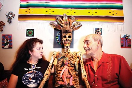 Mexico Lindo owners Lisa Digioia-Nutini and Jean-Pierre Nutini with wooden deer dancer from Guerrero. - PHOTO BY HEATHER MULL