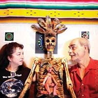 Mexico Lindo owners Lisa Digioia-Nutini and Jean-Pierre Nutini with wooden deer dancer from Guerrero.