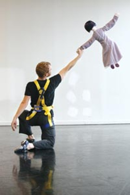 """Michael Walsh tunes his solo (with puppet) for """"4-2 Men."""" - HEATHER MULL"""