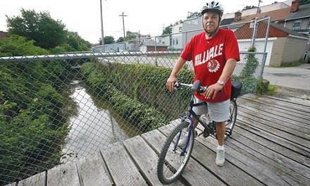 Millvale Mayor Vincent Cinski on two wheels. - HEATHER MULL
