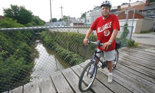 Millvale Mayor Vincent Cinski on two wheels. - HEATHER MULL