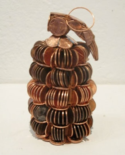 Mishq Laliwala's gleaming hand grenades of precariously stacked pennies.