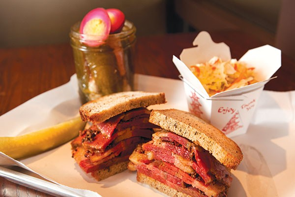 Montreal smoked-meat sandwich, pickle jar and coleslaw