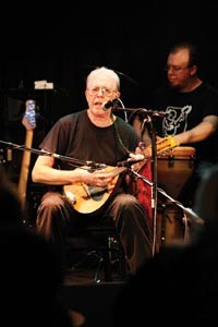 "Multi-instrumentalist Chuck Owston leads a fiery, medieval-sounding version of ""Gallows Pole,"" a traditional song made famous, he notes, by Led Zeppelin. An AcoustiCafe regular, he's joined here by house percussionist Eric George. - HEATHER MULL"