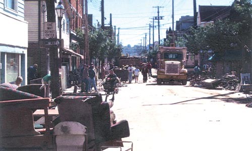 Neighbors scrap flood-damaged property, in 2004. - PHOTO PROVIDED BY FRED BOHN JR.