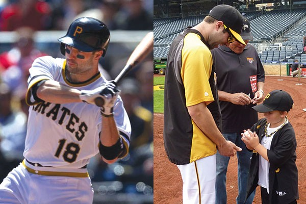 Neil Walker, at bat (left); Walker signs a ball for fan Bradyn Roberts.