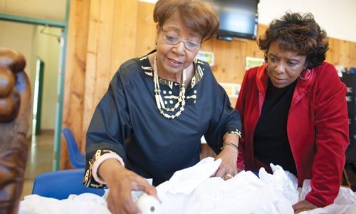Norma J. Thompson (left) shows family heirlooms to Marlene Scott Ramsey in preparation for The Women of the Hill. - RENEE ROSENSTEEL