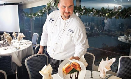 Not your ordinary fish dish: executive chef John Dober with king salmon Wellington, stuffed with black truffles - BRIAN KALDORF