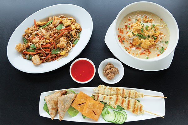 Nyat khaukswe kyaw noodles with shrimp; chicken noodle soup with coconut; and appetizer sampler: samosas, crispy tofu squares and chicken satay - PHOTO BY HEATHER MULL