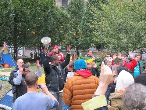 Occupiers take a vote at today's General Assembly at noon. - PHOTO BY CHRIS YOUNG
