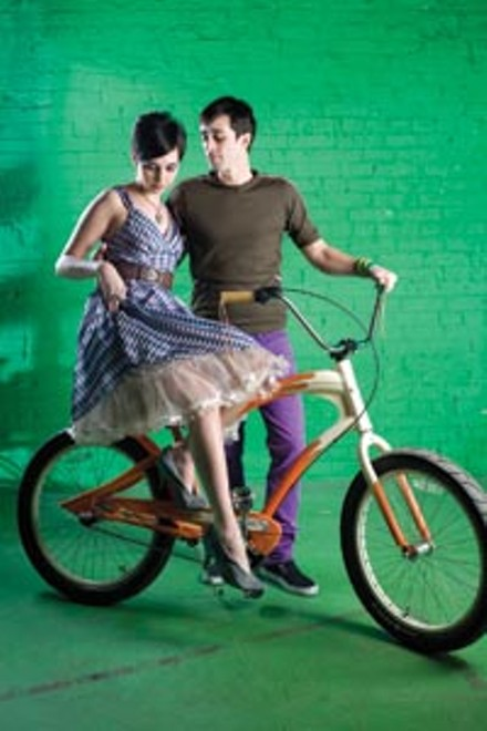 """On Bahareh: Plaid """"Poise"""" dress and """"Xena"""" belt, available from ModCloth.com. Steven Webster """"Superstud"""" sterling-silver and mother-of-pearl necklace and ring, available at Orr's Jewelers. """"Creamsicle"""" custom cruiser, available at Pro Bikes. - On James: Brown knit bike jersey, available from Built In Pittsburgh. Stretch slim slacks and wristband, both available at American Apparel. - HEATHER MULL"""