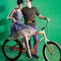 "On Bahareh: Plaid ""Poise"" dress and ""Xena"" belt, available from ModCloth.com. Steven Webster ""Superstud"" sterling-silver and mother-of-pearl necklace and ring, available at Orr's Jewelers. ""Creamsicle"" custom cruiser, available at Pro Bikes.               On James: Brown knit bike jersey, available from Built In Pittsburgh. Stretch slim slacks and wristband, both available at American Apparel."