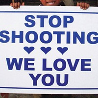 """One of Vanessa German's """"Stop Shooting We Love You"""" signs"""