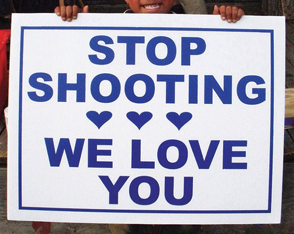"One of Vanessa German's ""Stop Shooting We Love You"" signs"