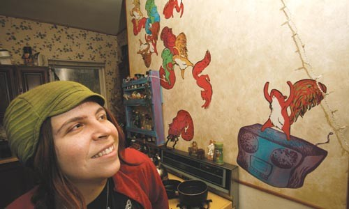 Operation Squirrel: Mary Tremonte, also a visual artist, alongside some of her creations - PHOTO BY HEATHER MULL