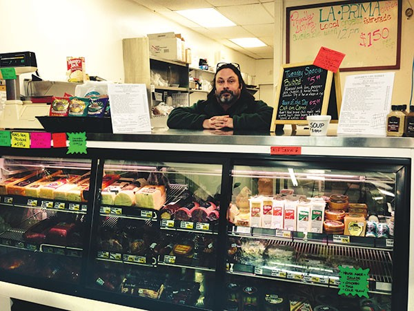 Owner Mike Mitchell at the deli counter - PHOTO BY LISA CUNNINGHAM