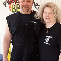 Pigs 2 Peaches Owners Jim and Jen Evans Photo by Heather Mull