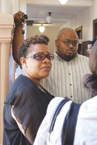 Pamela Lawton and the Rev. Cornell Jones speak to reporters outside Judge Anthony Mariani's courtroom Sept. 21. - PHOTO BY CHARLIE DEITCH
