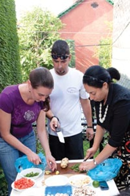 Pamela Reitsma, Jeremy Knapp and Mona Abdel-Halim learn how to cook Indian food during a Communiteach session in Bloomfield. - RENEE ROSENSTEEL