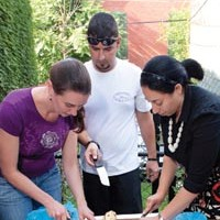 Pamela Reitsma, Jeremy Knapp and Mona Abdel-Halim learn how to cook Indian food during a Communiteach session in Bloomfield.
